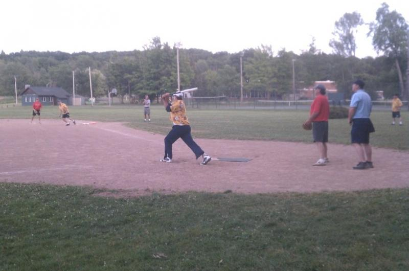 Larry Allen of the Birds strokes a double as base runner John Grabon and 1st bas